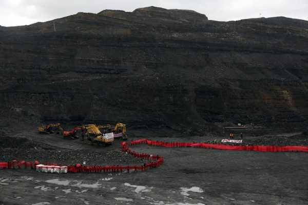 Protesters shut down digging in the Ffos-y-fran opencast coal mine in South Wales (photo: Kristian Buus, the Guardian)