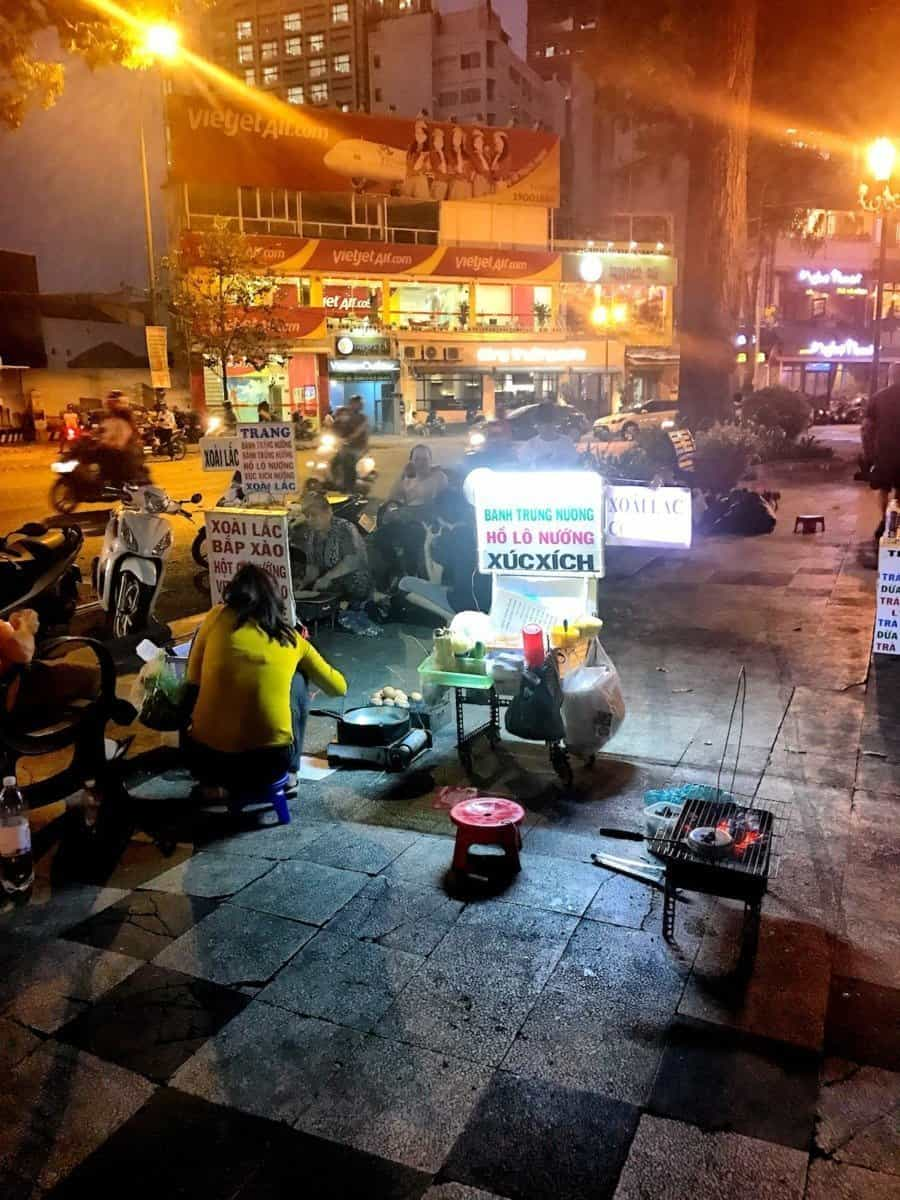 Night food stalls are everywhere and between them running rats