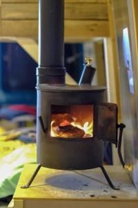 woodburner inside campingvan, campin in october