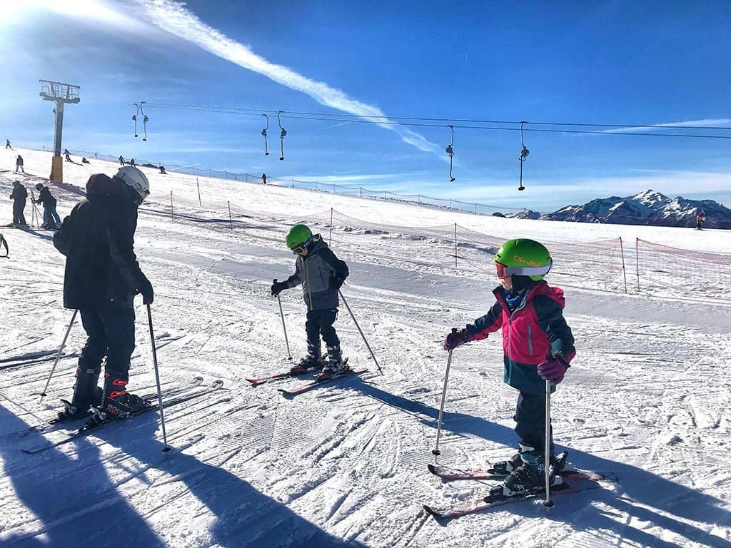 Children ski lesson on nursery slope in Tognola, San Martino di Castrazzo
