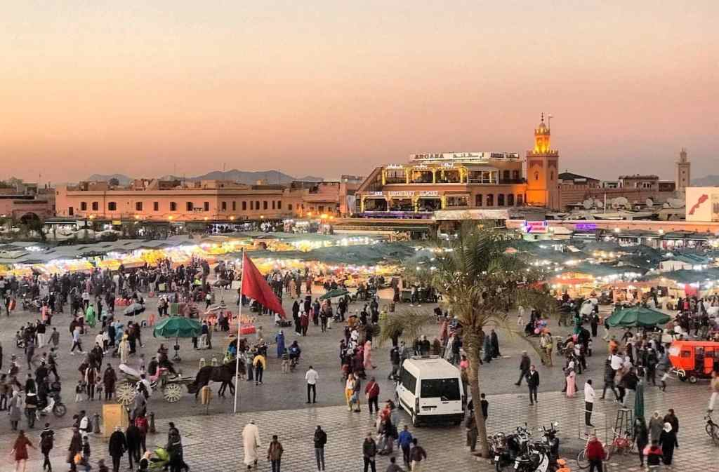 when you in Marrakech With Kids in Jemaa el-Fna Square keep your kids tight by the hand or best observe Square from roof top restaurant