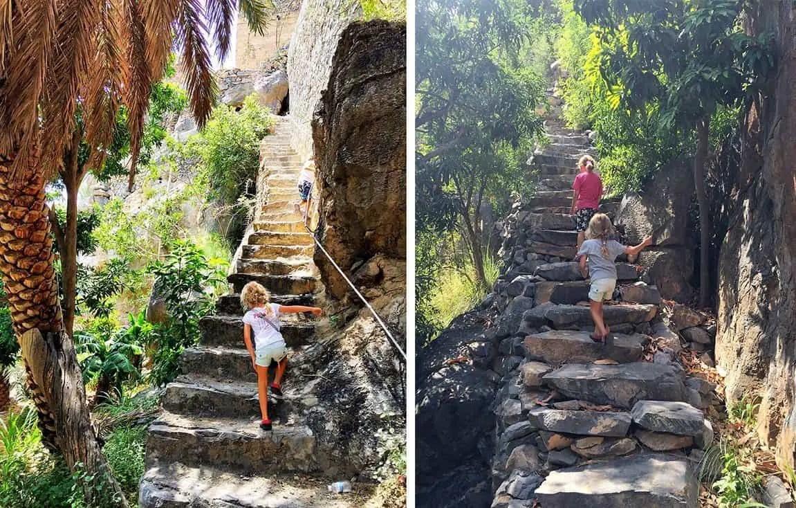 Misfat al Abriyeen trekking  - girls climbing old stairs