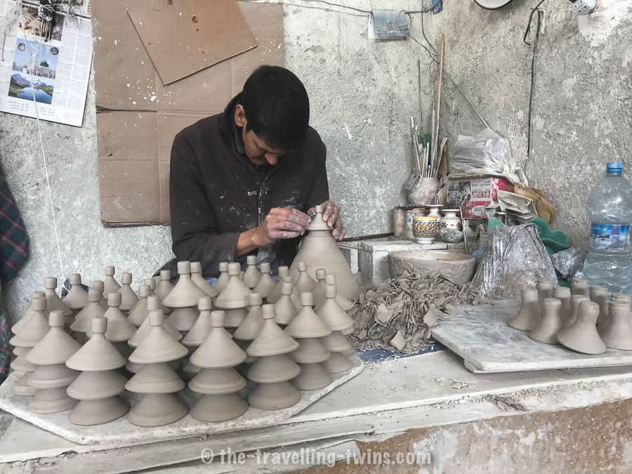 Ceramic artist - creating tajine dish