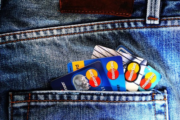 Where to find the best online savings account interest rates. Jeans pocket with credit cards sticking out.