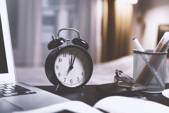 Saving time - alarm clock on desk