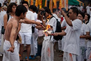 Ma Song performing a ritual with incense sticks.