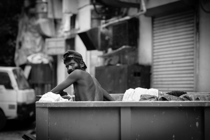 brickfields rubbish skip street man
