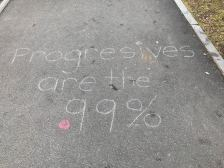 Protesters not only wrote on posters but in chalk on the city grounds as well. (Photo by Morgan Vanwickler)