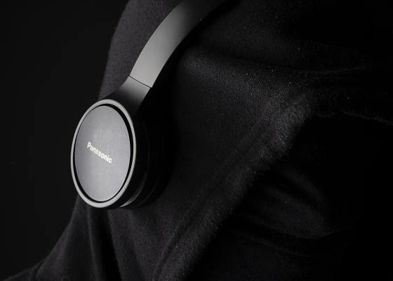 person in black hoodie wearing headphones