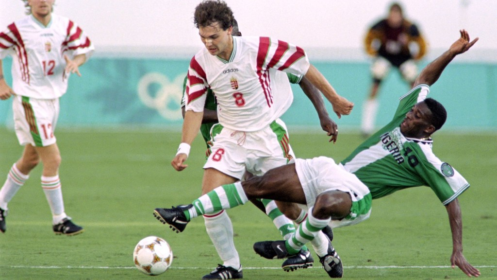 Okocha tackles a Hungarian player during first round play