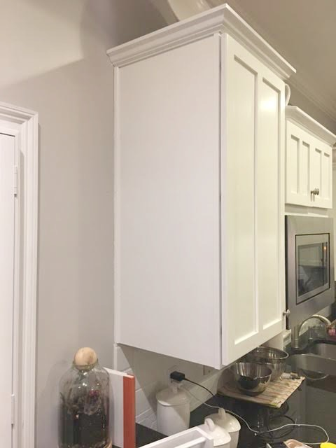 kitchen storage is easy with the addition of ikea shelves.