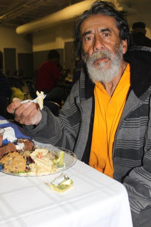 Thankful diner at Thanksgiving Dinner at Cardinal Manning Center in the heart of LA's Skid Row.