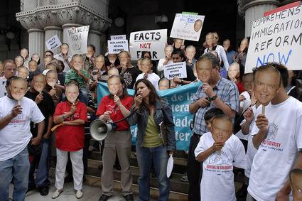 Protesters In Lou Dobbs Masks