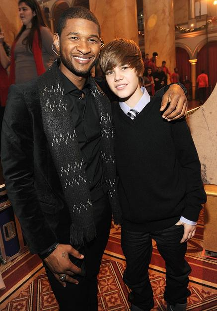 Usher poses with his protege, Justin Bieber, at the Christmas in Washington holiday concert. The 15-year-old YouTube sensation was proud to sing Stevie Wonders Someday at Christmas for President Obama and First Lady Michelle Obama.
