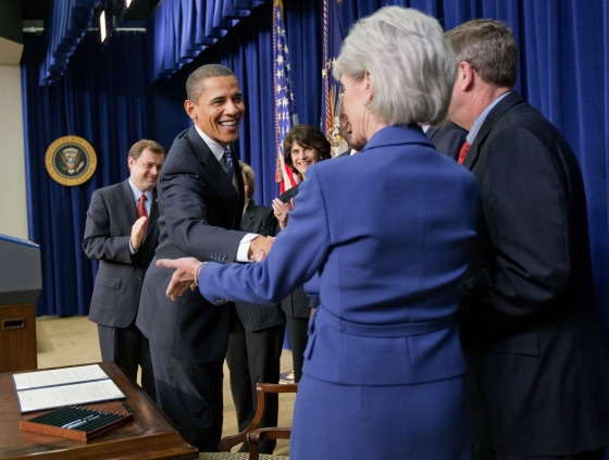 President Barack Obama shakes hands with Health and Human Services Secretary Kathleen Sebelius after signing a memorandum expanding government funded health clinics across the country, Dec. 9, 2009