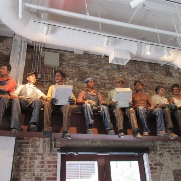 Men on a beam