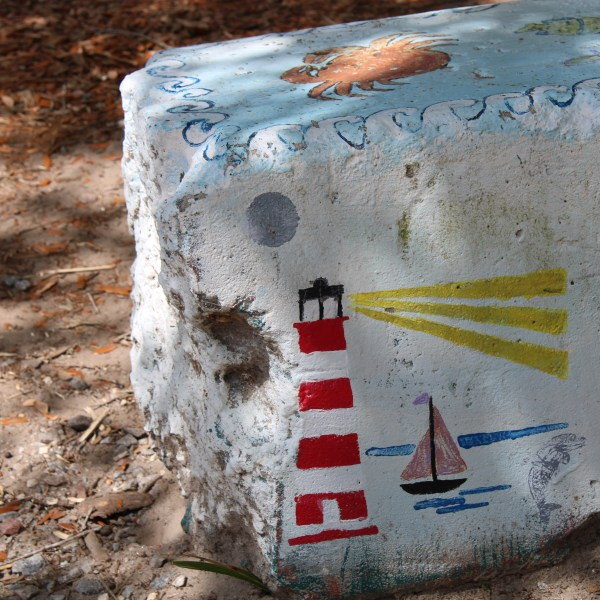 Lighthouse painted on a bench