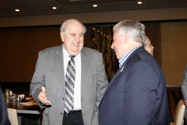 Former Texas SID Bill Little speaks with Mike Finn of the Atlantic Coast Conference. Photo by Melissa Macatee.
