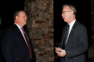 Ed Grom (left) of the American Sports Network, which along with the National Football Foundation sponsored the FWAA Past Presidents Dinner, chats with FWAA Board Member Malcolm Moran. Photo by Melissa Macatee.