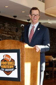 Ivan Maisel of ESPN.com addresses the membership after receiving the FWAA's Bert McGrane Award on Jan. 11, 2016. Photo by Melissa Macatee.