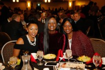 Friends and family of 2016 Outland Trophy winner Cam Robinson of Alabama, from left: his girlfriend Jasmine Blair, his sister Charity Robinson and his mother Priscilla Robinson at the Outland Trophy Presentation Banquet on Jan. 11, 2017, in Omaha. Photo by C41 Photography.