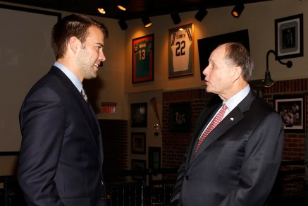 Zach Terrell, Western Michigan quarterback and winner of the Campbell Trophy, talks with Charlie Fiss, winner of the 2017 Bert McGrane Award, at the FWAA's Awards Breakfast on Jan. 9, 2017, in Tampa. They got to know each other earlier when Western Michigan came to Dallas to play Wisconsin in the Cotton Bowl, for which Fiss works as vice president of communications. Photo by Melissa Macatee.