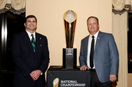 Matt Sign of the National Football Foundation and Ed Grom of the American Sports Network, sponsor of the FWAA Past Presidents Dinner on Jan. 6, 2017, in Tampa. Photo by Melissa Macatee.