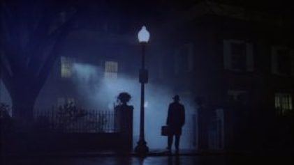 The iconic image of Father Merrin standing outside Regan's house