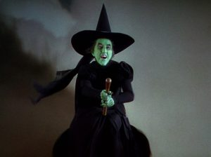 The Wicked Witch of the West on her broom