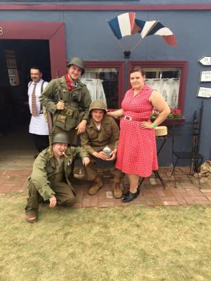 The soldiers pose with one of the friendly French women. Credit: Melanie Krahling.