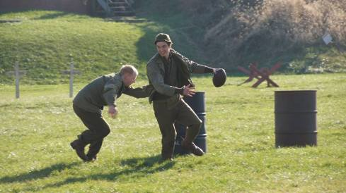 A soldier breaks away from his friend's tackle in a friendly game of football. Credit: Melanie Krahling.