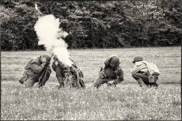 The 94th launches a coordinated mortar attack on a French village occupied by German soldiers. Credit: Unknown.