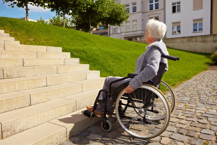 inaccessible, lady in wheelchair stopped at steps