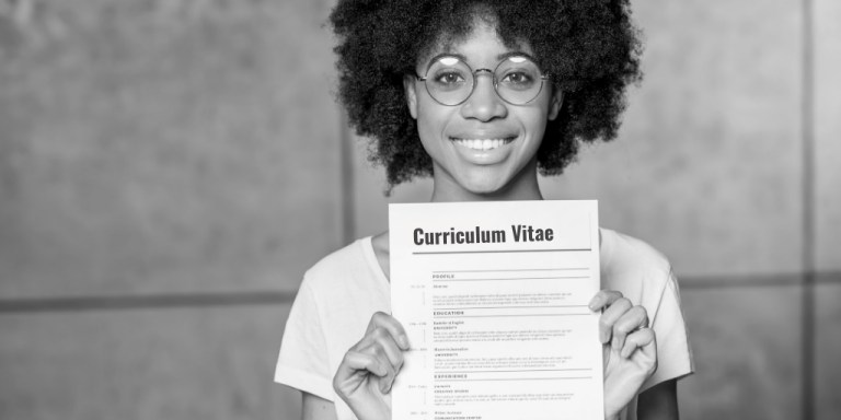 Woman holding a curriculum vitae (C.V.)