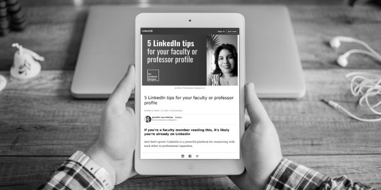 Hands holding a tablet with a LinkedIn article on it