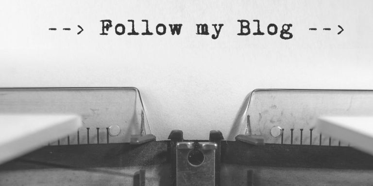 'Follow my blog' spelled out on typewriter