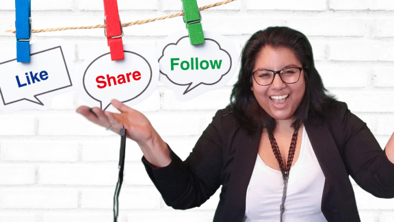 A photo of Jennifer van Alstyne smiling with her arms open, above head hang signs of speech bubbles that read 'follow,' like,' and 'share'