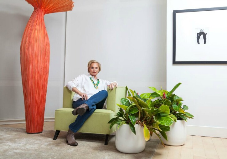randy rubin sitting on a green chair