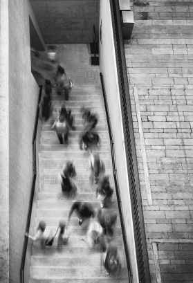 people in motion going through a doorway