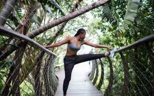 photo of woman stretching on handrails