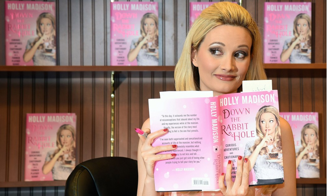 Holly Madison with her book Down the Rabbit Hole