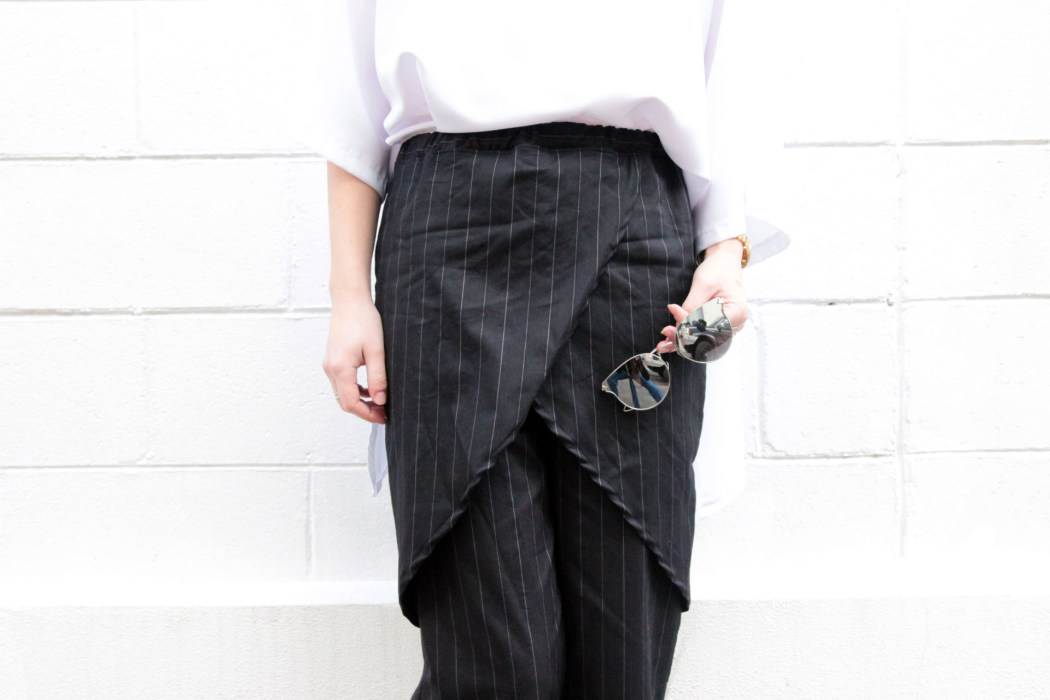 Kristen wears the 'Blackbird' Pinstripe Apron Pant and the 'Observations' Top