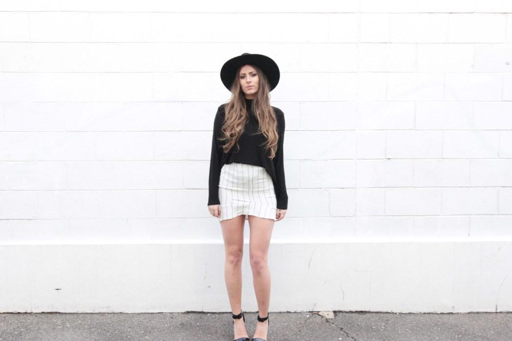 Mel wears the Zoe Elizabeth 'Drifter' Black Jersey Top and 'Ruby Tuesday' Crepe De Chine Skirt.