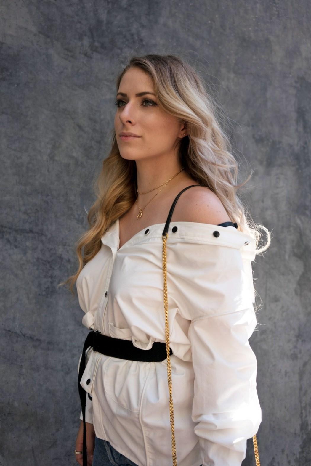 Mel wears Lucid Label's Off-Shoulder Boyfriend Shirt in Ivory.