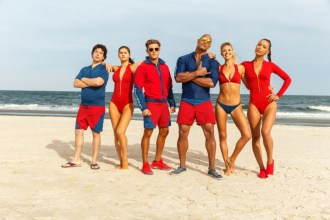 (L-R) Jon Bass plays Ronnie, Alex Daddario plays Summer, Zac Efron plays Matt Brody, Dwayne Johnson plays Mitch Buchannon, Kelly Rohrbach plays CJ Parker, and Ilfenesh Hadera plays Stephanie Holden in BAYWATCH; the film by Paramount Pictures.