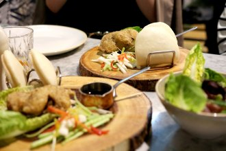 Confit duck bao bun at Romulo Cafe.
