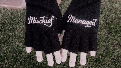 Mischief managed Harry Potter fingerless gloves from Hot Topic