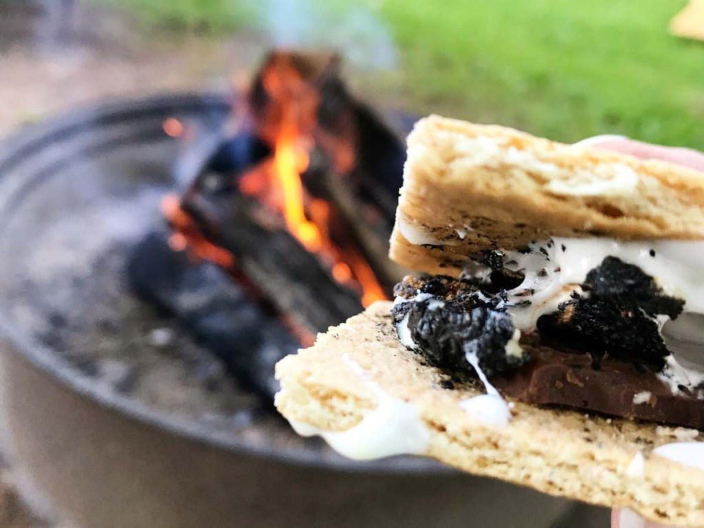 Lighting a Fire Pit and Make S'mores is one of the fun summer bucket list ideas