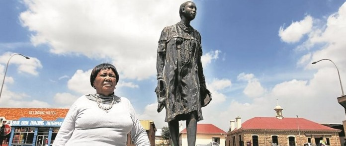 Sizakele Simelane at the statue of her daughter Nokuthula in Bethal Photo: KEVIN
