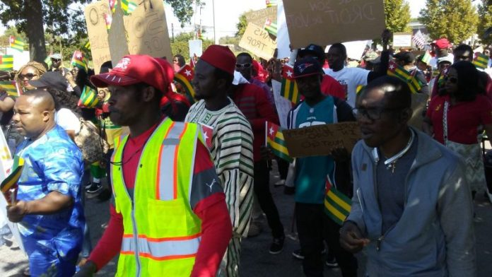Togolese in Minnesota take to the Capitol. Photo: The AfricaPaper/James K. Fasuekoi